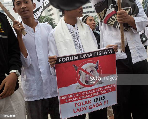 Indonesian Muslim activists hold an anti Lady Gaga poster during a protest against pornography and drugs in Jakarta on June 1 2012 Dozens of Islamic...