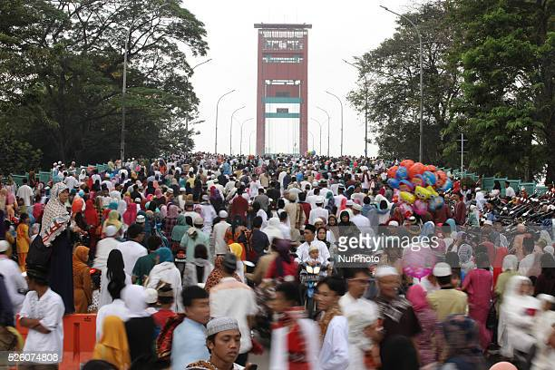 Indonesian muslim attend the morning prayer to celebrate the Eid AlFitr at Sultan Mahmud Badaruddin II Mosque on july 17 2015 in Palembang Indonesia...