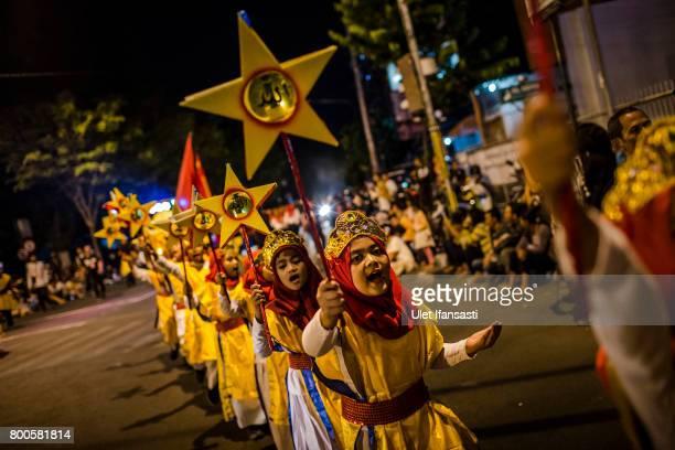 Indonesian Muslim children parade on the streets as Muslims celebrate Eid AlFitr on June 24 2017 in Yogyakarta Indonesia Eid AlFitr marks the end of...