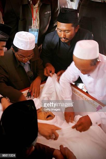 Indonesian Muslim clerics prepare the body of former Indonesian President Abdurrahman Wahid before his funeral on December 31 2009 in Jombang...
