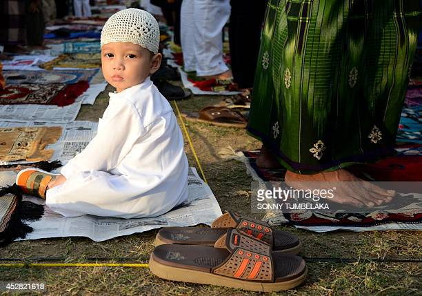 Indonesian Muslim gather for special prayers near the Bajrah Sandhi monument in Denpasar on Bali island on July 28 2014 The Muslim festival of Eid...