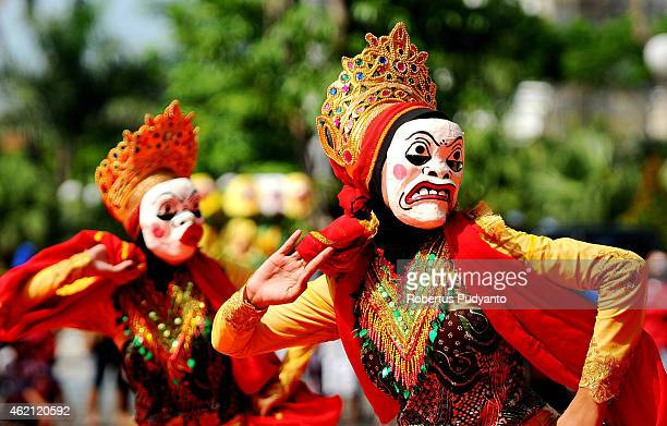 Indonesian Muslim girls dance during the Mawlid Mask Festival to commemorate the birthday of the Prophet Mohammad on January 25 2015 in Surabaya...