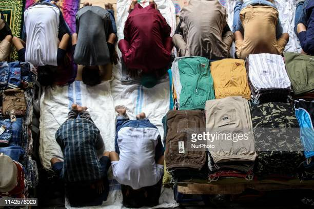 Indonesian Muslim pray during Friday prayers in the holy month of Ramadan at Tanah Abang Textile Market in Jakarta Indonesia on May 10 2019
