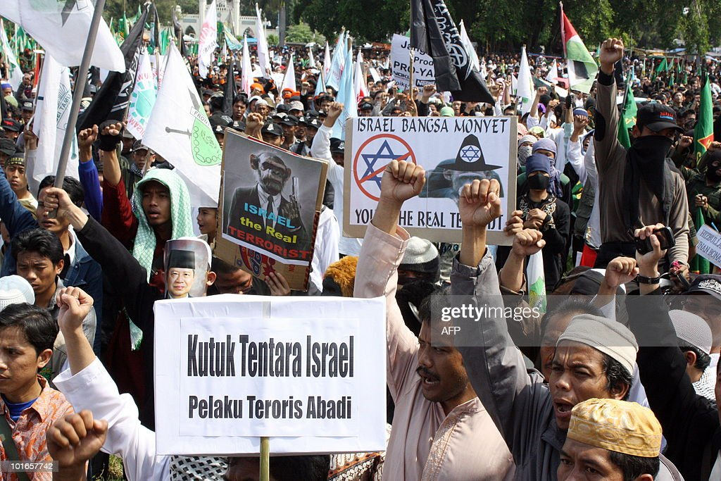 Indonesian Muslim protesters shout slogans during a demonstration against Israel's assault on a Gaza-bound aid flotilla in which nine activists were killed and scores wounded, in Solo on June 6, 2010. International pressure mounted on Israel to conduct independent inquiry into the bloody raid when Israeli commandos clashed with international activists as they attempted to turn back the aid flotilla in line with Israel's blockade of the Hamas-ruled Gaza Strip.