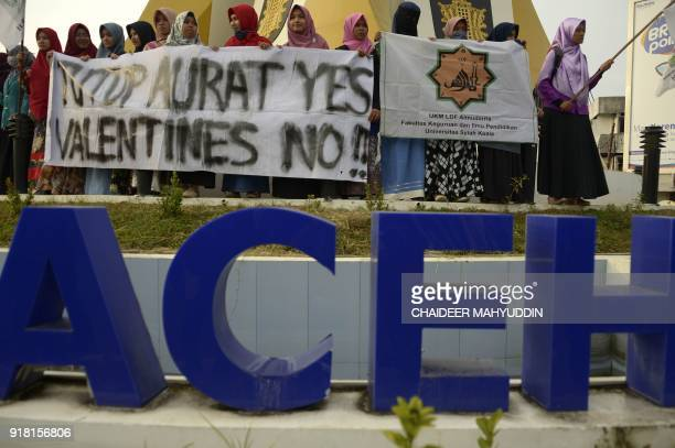 Indonesian Muslim students hold a protest against Valentine's Day in Banda Aceh on February 14 2018 Valentine's Day was banned in some Indonesian...