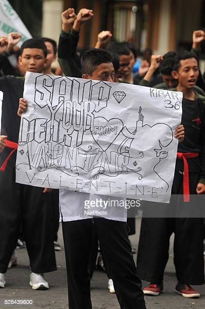 Indonesian muslim students holds a banners during an antiValentine protest in Surakarta Central Java Indonesia on February 13 Islamic conservatives...