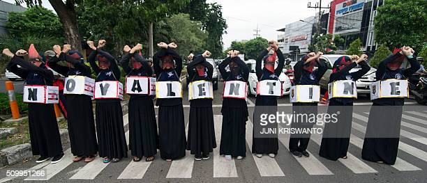 Indonesian Muslim women take part in a protest against the celebration of Valentine's Day in Surabaya on February 13 2016 Muslim clerics across...