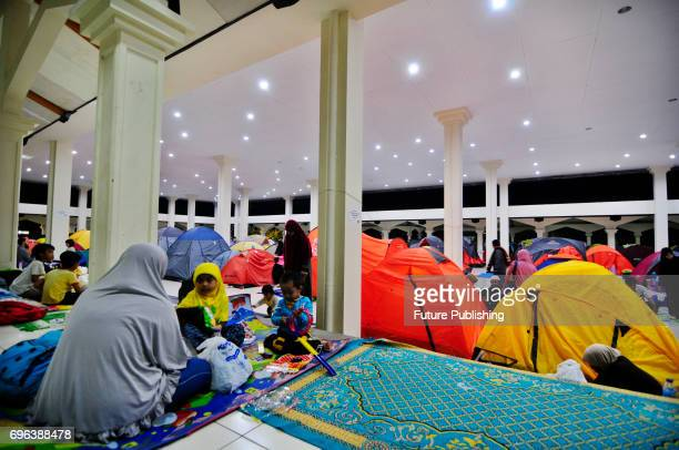 Indonesian Muslims are seen at the Habibburahman Grand Mosque for Itikaf a spiritual practice held during the last ten days of Islamic fasting month...