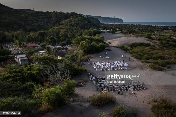 Indonesian muslims attend an Eid Al-Fitr prayer on the 'sea of sands' at Grogol village on May 13, 2021 in Yogyakarta, Indonesia. Eid al-Fitr marks...