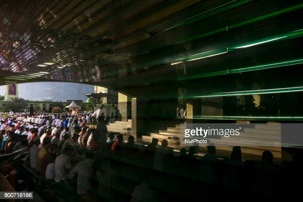 Indonesian Muslims attend Eid AlFitr prayer at AnNur Grand Mosque on June 25 2017 in Pekanbaru Indonesia Eid AlFitr marks the end of Ramadan during...