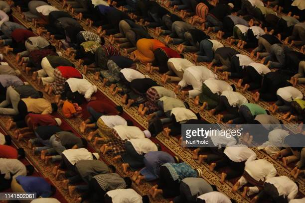 Indonesian Muslims attend the first Tarawih prayer in the Grand Mosque of Bogor West Java Indonesia on Sunday May 5 2019 The government sets 1...