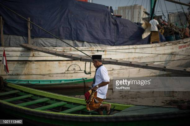 Indonesian muslims back towards home after offering ritual prayer during celebration of Eid alAdha at the centuriesold Sunda Kelapa port in Jakarta...