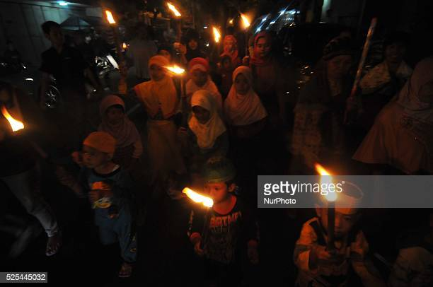 Indonesian muslims bring a torch and read sentences quotAllahu Akbar / Allah almightyquot during take part a javanese ritual to celebrated ied alFitr...