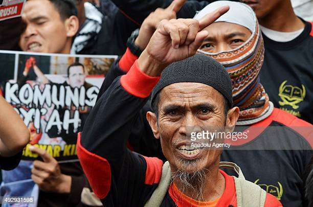 Indonesian Muslims chant slogans during a protest against Russia's military intervention in Syria in front the Russian Embassy in Jakarta Indonesia...