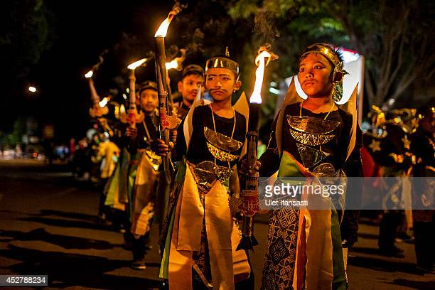 Indonesian muslims children carry torches as they parade on the streets ahead of Eid AlFitr on July 27 2014 in Yogyakarta Indonesia Muslims will...