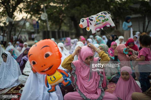 Indonesian Muslims gather outside a mosque before Eid alAdha prayers in at the centuriesold Sunda Kelapa port in Jakarta on August 22 2018 Eid alAdha...
