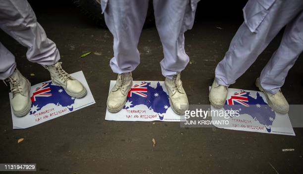 TOPSHOT Indonesian Muslims hold a rally in Surabaya in East Java on March 22 to condemn the attacks on two mosque in New Zealand New Zealand...