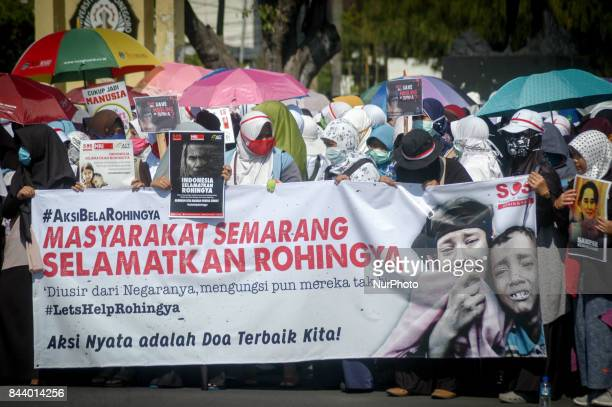 Indonesian Muslims hold banners and shout slogans during a protest in Semarang Central Java Province Indonesia on September 08 condemning the Myanmar...