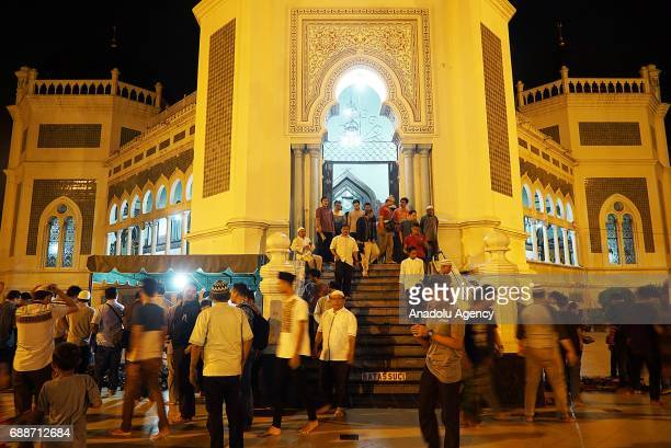 Indonesian Muslims leave after performing the first 'Tarawih' prayer on the eve of the Islamic holy month of Ramadan at the Raya Mosque in Medan...