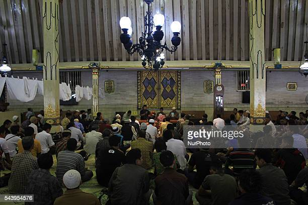 Indonesian muslims listen the preaching before break their fast at Kauman Great Mosque Yogyakarta Indonesia on June 30 2016 The Islamic holy month of...