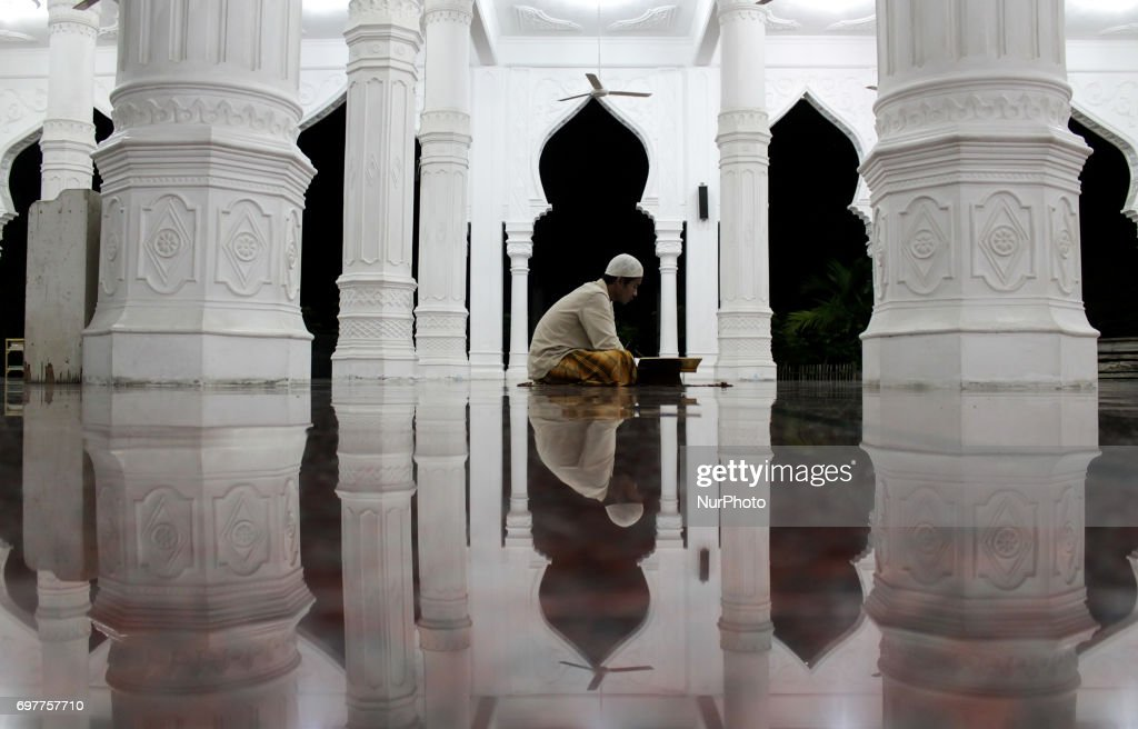 Indonesian Muslims offer prayers and read the Qur'an in the last 10 days of Ramadan at the Al Hikmah Mosque on June 19, 2017. in Lhokseumawe, Aceh Province, Indonesia. More than 1.5 billion Muslims around the world will mark the month, during which believers abstain from eating, drinking, and smoking from dawn until sunset.