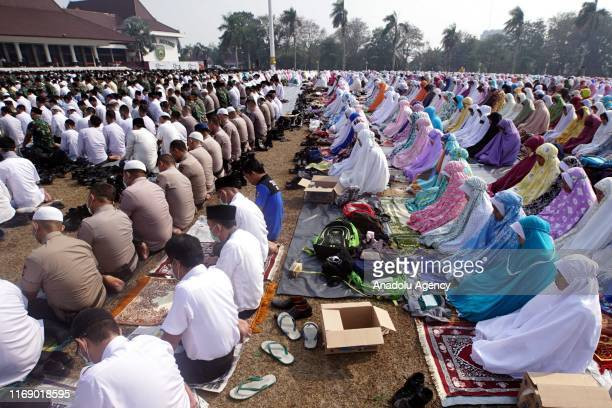 Indonesian Muslims perform a mass prayer for rain to combat the haze and drought season in Palembang Indonesia on September 18 2019 Forest and land...