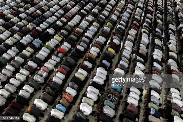 Indonesian Muslims perform Eid AlAdha prayer at Islamic Centre Mosque Lhokseumawe on September 1 2017 in Aceh Province Indonesia Muslims throughout...