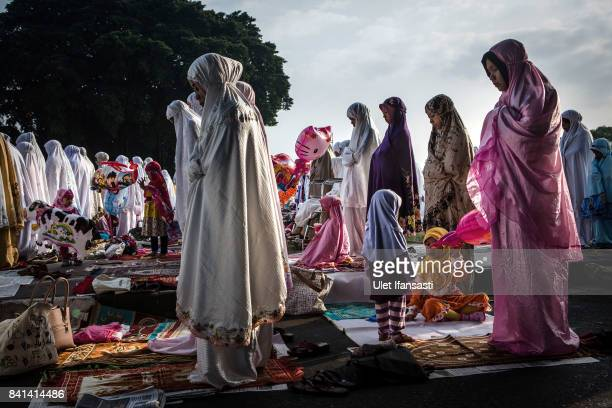 Indonesian Muslims perform Eid alAdha prayer at southern city square known as 'Alunalun kidul' on September 1 2017 in Yogyakarta Indonesia Muslims...