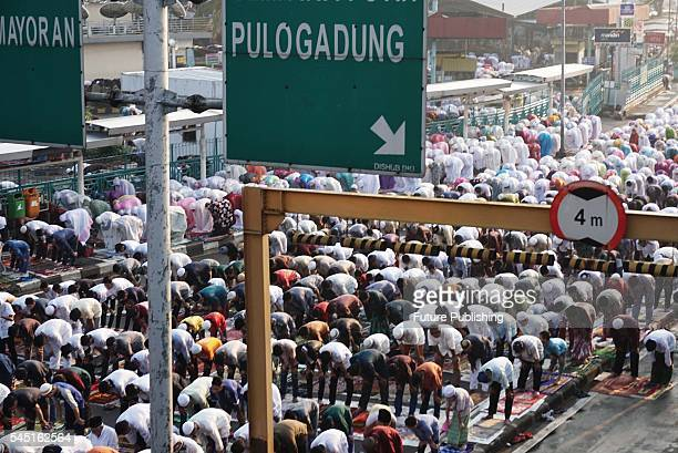 Indonesian muslims perform Eid elFitr prayer at Pasar Senen on July 6 2016 in Jakarta Indonesia Eid alFitr is a religious holiday celebrated by...