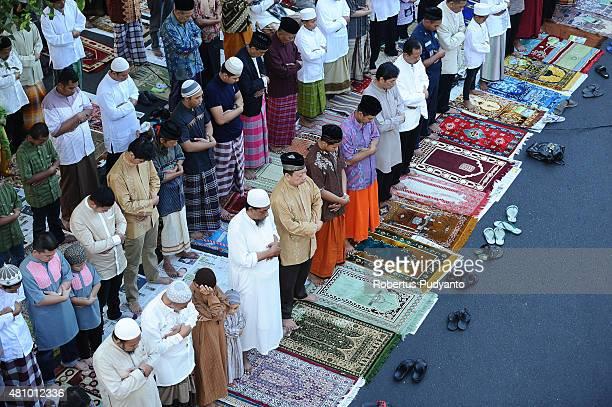 Indonesian Muslims perform Eid prayer on July 17 2015 in Surabaya Indonesia Muslims worldwide observe the Eid AlFitr prayer to mark the end of...