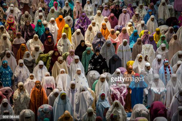 Indonesian muslims perform prayers known as Tarawih at Grand mosque on May 16, 2018 in Surabaya, Indonesia. Indonesia will begin observing Ramadan on...