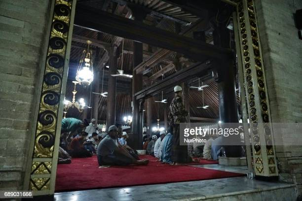 Indonesian muslims performs a prayer known as Tarawih at Kauman Great Mosque Yogyakarta Indonesia on May 27 2017 Millions of Muslims around the world...