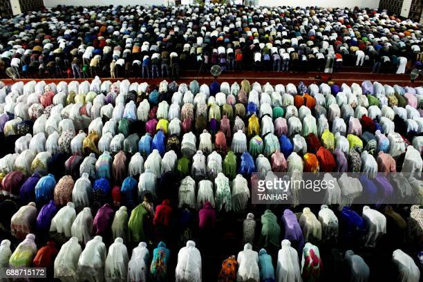 Indonesian Muslims pray during the start of the holy month of Ramadan on May 26 2017 in Padang West Sumatra province More than 15 billion Muslims...
