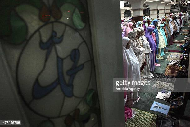 Indonesian Muslims pray in first Tarawih during the first night of the holy month of Ramadan at the Al Azhar mosque in Jakarta Indonesia on June 17...