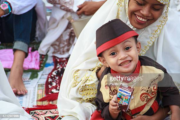 Indonesian Muslims pray to celebrate Eid ulFitr at Sunda Kelapa Port Muslims around the world are celebrating Eid alFitr which marks the end of the...