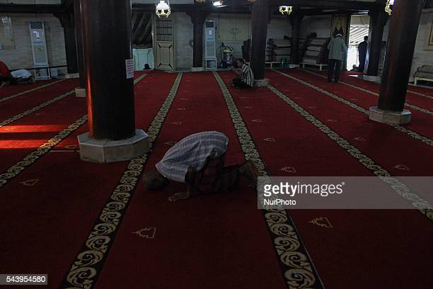 Indonesian Muslims praying at Kauman Great Mosque Yogyakarta Indonesia on June 30 2016 The Islamic holy month of Ramadan is celebrated by Muslims...