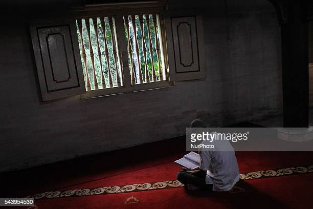 Indonesian Muslims read the Qur'an at Kauman Great Mosque Yogyakarta Indonesia on June 30 2016 The Islamic holy month of Ramadan is celebrated by...