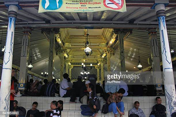 Indonesian Muslims sits as waiting to break fasting at Kauman Great Mosque Yogyakarta Indonesia on June 30 2016 The Islamic holy month of Ramadan is...