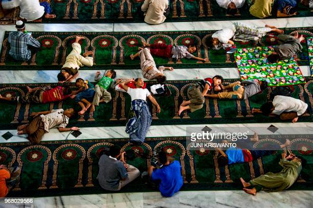 TOPSHOT Indonesian Muslims sleep in a mosque in Surabaya East Java on June 6 2018 as part of their belief that the last ten days of the holy month of...