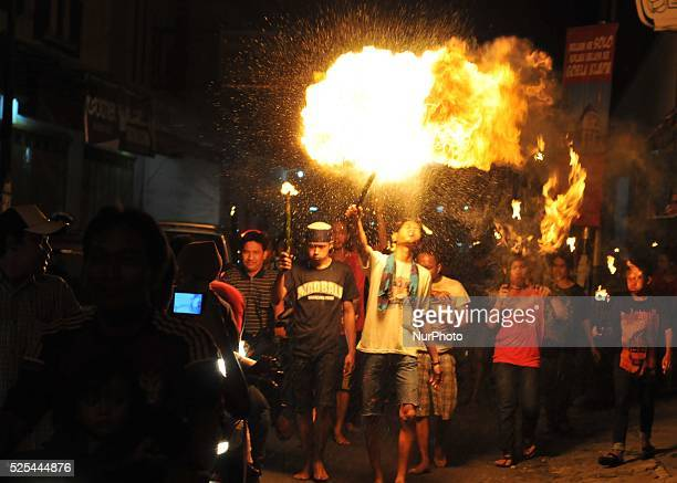 Indonesian muslims spitting fire using kerosene during take part a javanese ritual called quottakbiranquot to celebrated Ied alFitr in Surakarta...