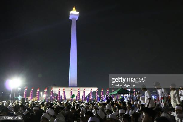Indonesian Muslims take part in the procession commemorating the birth of Muslims' beloved Prophet Muhammed known in Arabic as Mawlid alNabi at Monas...