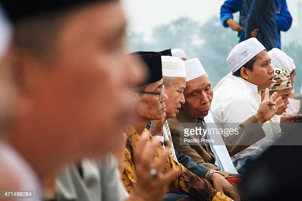 Indonesian Muslims use a telescope to hold a Rukyatul Hilal to see the new crescent moon that determines the end of Ramadan at Mosque AlMusyari`in...