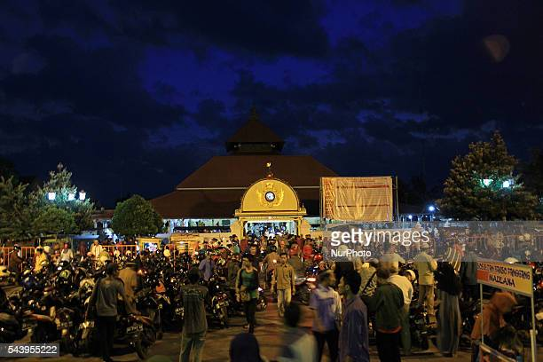 Indonesian Muslims walked out from the Kauman Great Mosque Yogyakarta Indonesia on June 30 2016 The Islamic holy month of Ramadan is celebrated by...