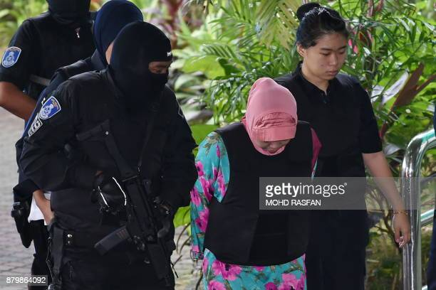 Indonesian national Siti Aisyah is escorted by Malaysia police during a court appearance with Vietnamese national Doan Thi Huong at the Shah Alam...