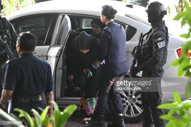 Indonesian national Siti Aisyah is escorted by Malaysian police at the Shah Alam High Court outside Kuala Lumpur on March 11 2019 to stand trial for...