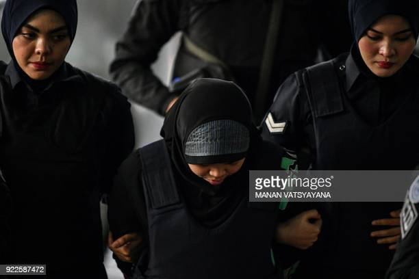 Indonesian national Siti Aisyah is escorted by Malaysian police for another appearance at court for her trial at the Shah Alam High Court in Shah...