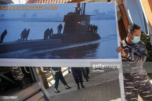 Indonesian navy officer prepares at rescue command centre for missing Indonesian navy submarine KRI Nanggala 402 at Ngurah Rai Military Air Base in...