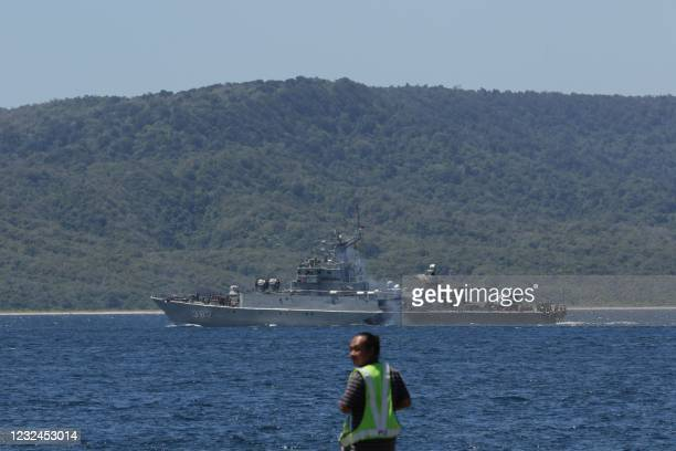 Indonesian navy ships arrive at the naval base in Banyuwangi on April 22 to join in the search for a decades-old navy submarine that went missing off...