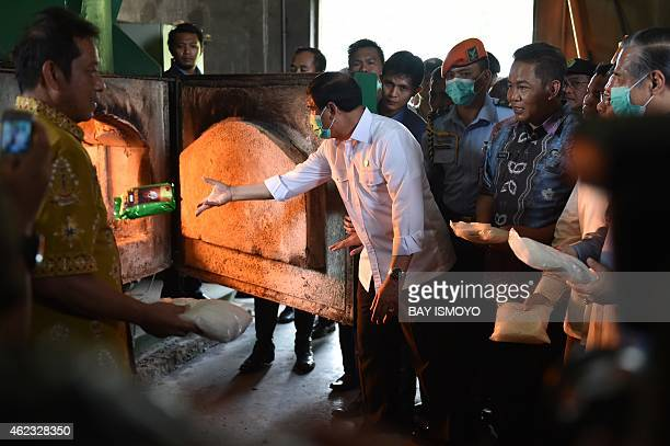 Indonesian officials and suspects destroy some of the 862 kilograms of crystal methamphetamine during a ceremony in Tangerang on the outskirt of...