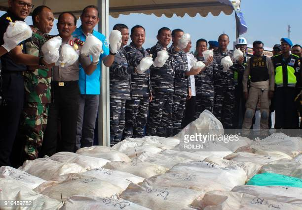 Indonesian officials display more than a tonne of methamphetamine in Batam island on February 10 2018 after a navy boat patrolling the Phillip...